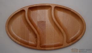 Oval dish for snacks with three compartments
